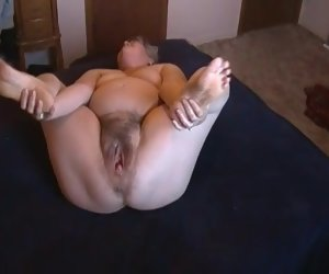 6:46 , Kim Bates strips and toys muted pussy. Can you help?