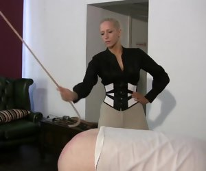 5:20 , slave gets caned by strict festival mistress