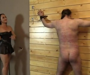 17:26 , Cruel pitch-dark mistress whips and canes her slave tied less the wall